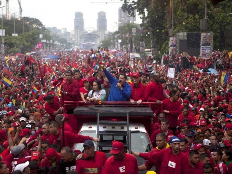 Venezuela's President Hugo Chavez delivers a speech from the top of a vehicle during his closing campaign rally in Caracas, Venezuela. Chavez is running for re-election against opposition candidate Henrique Capriles. (AP Photo)
