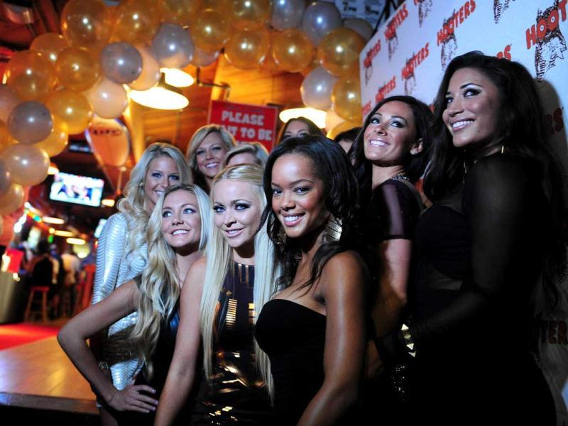 Calendar girls pose on arrival for the 2013 Hooters Calendar release party in California. There are now more than 400 Hooters restaurants across the US and over 20 in other countries. (AFP Photo)