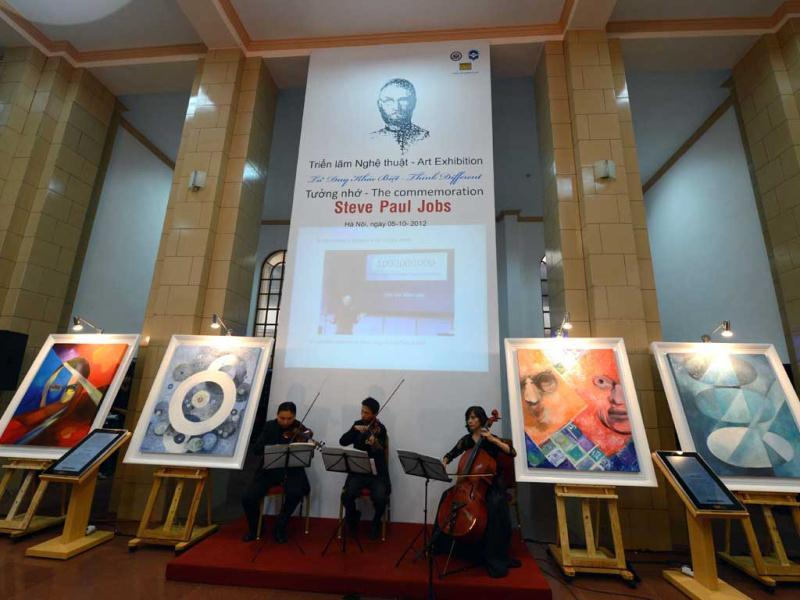 Musicians perform during the opening ceremony of an art exhibition in commemoration of the late Apple's co-founder Steve Jobs on the occasion of his first death anniversary in Hanoi. The art exhibition entitled