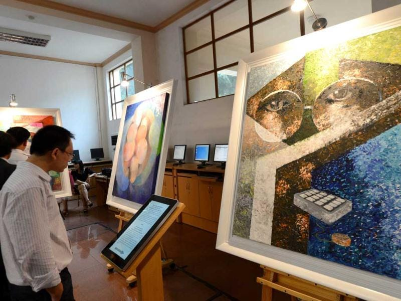 People attend the opening ceremony of an art exhibition in commemoration of the late Apple's co-founder Steve Jobs on the occasion of his first death anniversary in Hanoi. The art exhibition entitled