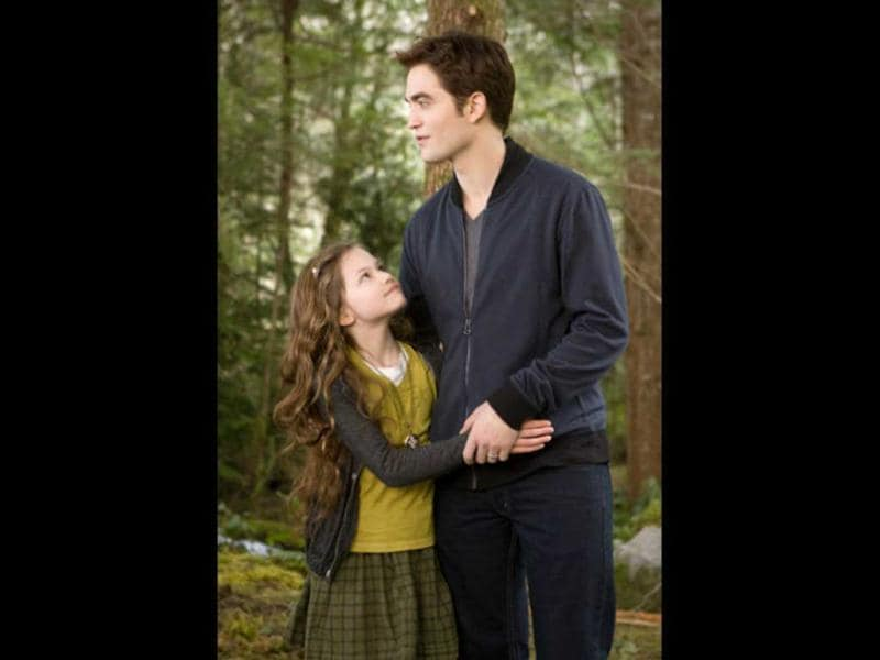Edward Cullen with his daughter Renesmee.