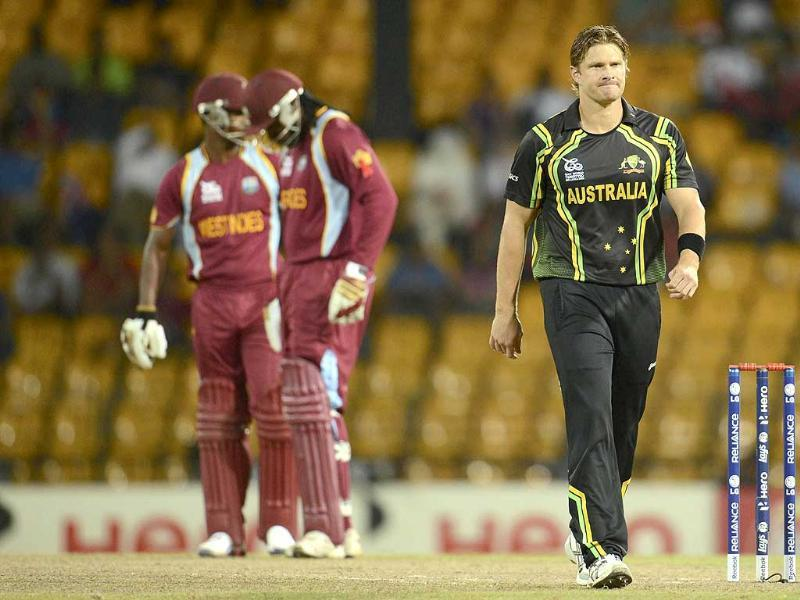 Australia's Shane Watson (R) walks back to his bowling mark during the ICC world Twenty20 semi-final against the West Indies at the R Premadasa Stadium, Colombo. Reuters Photo