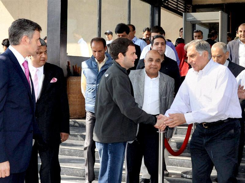 Jammu and Kashmir chief minister Omar Abdullah looks on as Congress leader Rahul Gandhi and industrialist Ratan Tata shake hands at a business luncheon meeting in Srinagar. PTI Photo