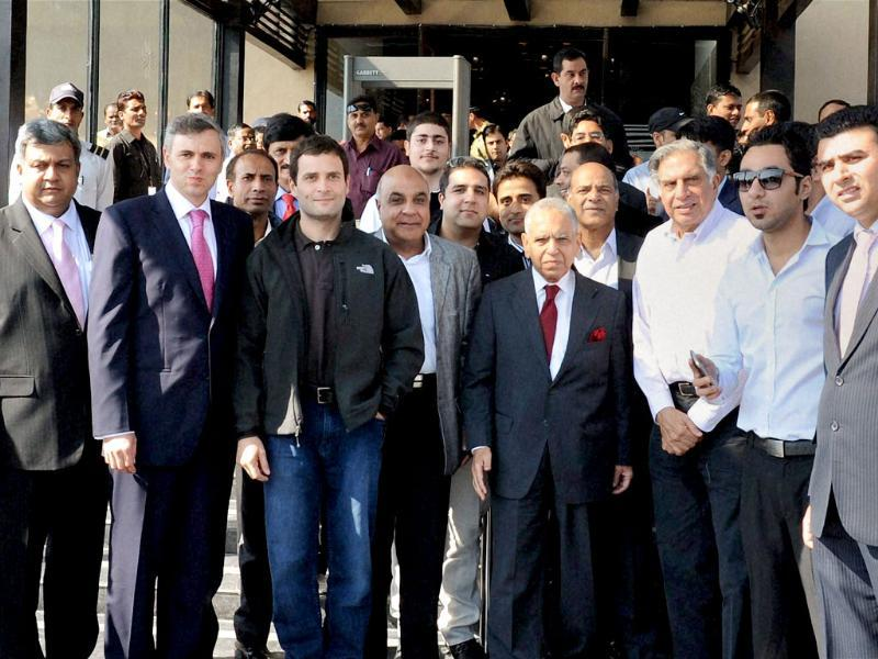 Jammu and Kashmir chief minister Omar Abdullah, Congress leader Rahul Gandhi and industrialist Ratan Tata with Kashmiri businessmen at a luncheon meeting in Srinagar. PTI Photo