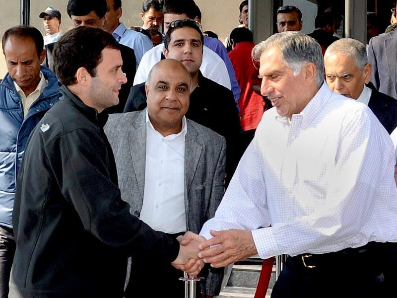 Congress leader Rahul Gandhi and industrialist Ratan Tata shake hands at a business luncheon meeting in Srinagar. PTI Photo