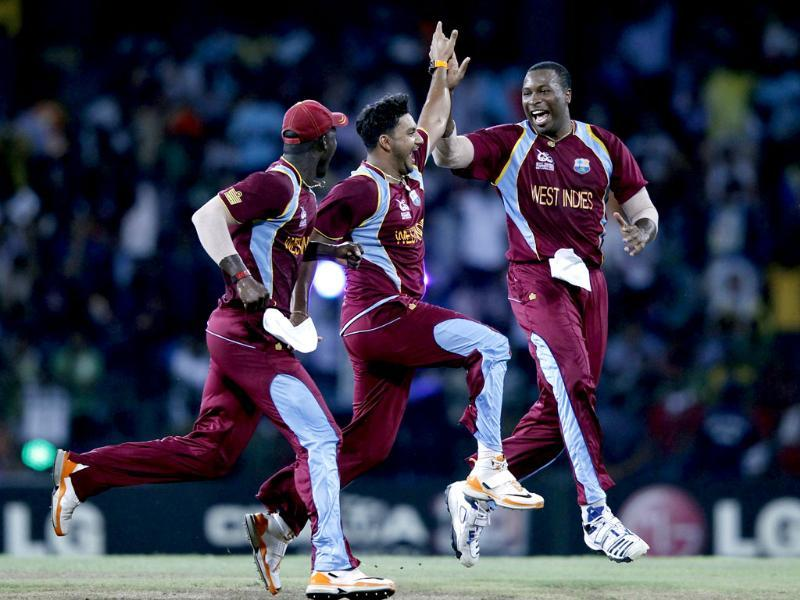 West Indies Ravi Rampaul (C) celebrates with his teammate Kieron Pollard (R) and captain Darren Sammy after taking the wicket of Australia David Hussey during their Twenty20 World Cup semi-final cricket match in Colombo. Reuters Photo/Dinuka Liyanawatte
