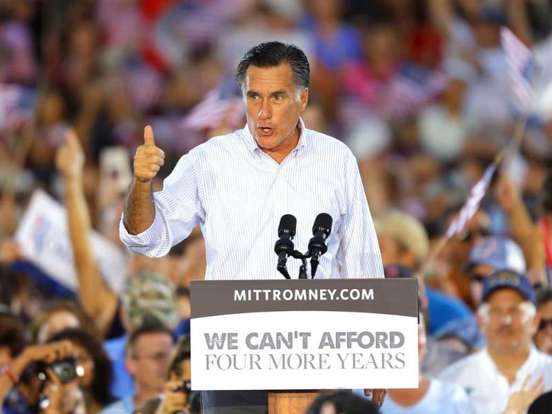Republican Presidential candidate and former Massachusetts Governor Mitt Romney gestures as he speaks to supporters during a campaign rally in St. Petersburg, Florida. (AP Photo/Chris O'Meara)