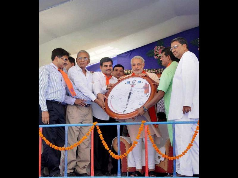 Gujarat chief minister Narendra Modi is presented with a clock during his Swami Vivekananda Yuva Vikas Yatra in Morbi town of Rajkot district. PTI