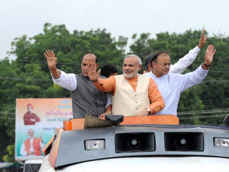Gujarat state chief minister, Narendra Modi is accompanied by former Bhartiya Janta Party (BJP) president, Rajnath Singh and leader of opposition in Rajya Sabha, Arun Jaitley as he kicks off his month-long Vivekanand Yuva Vikas Yatra at Becharaji town, some 110 kms from Ahmedabad. AFP/Sam Panthaky