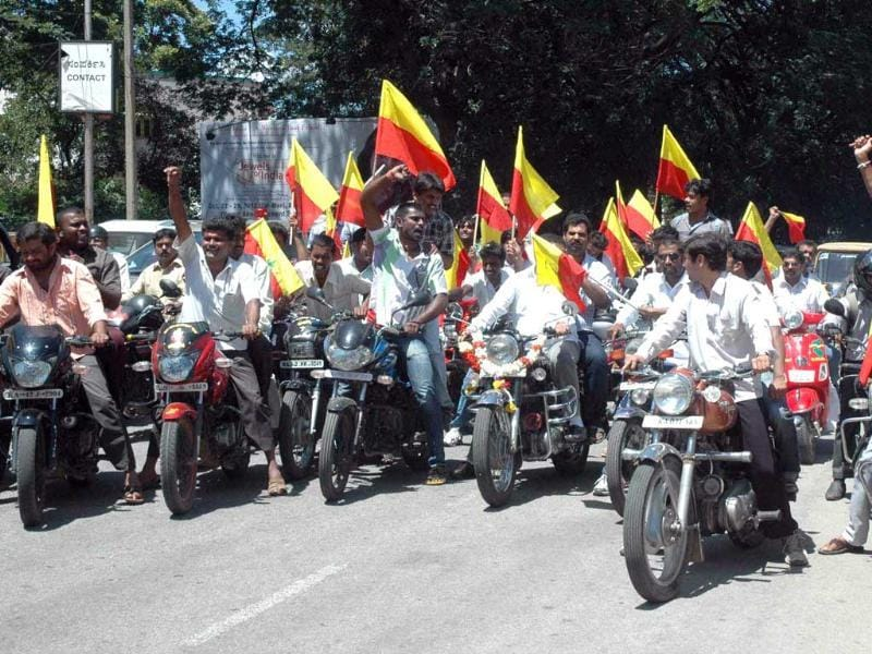 Members of Late G Narayan Kumar-Kannada Chaluvalli Kendra Samithi-youth wing taking out a protest motor bike rally on cauvery water issue in Bangaluru. UNI