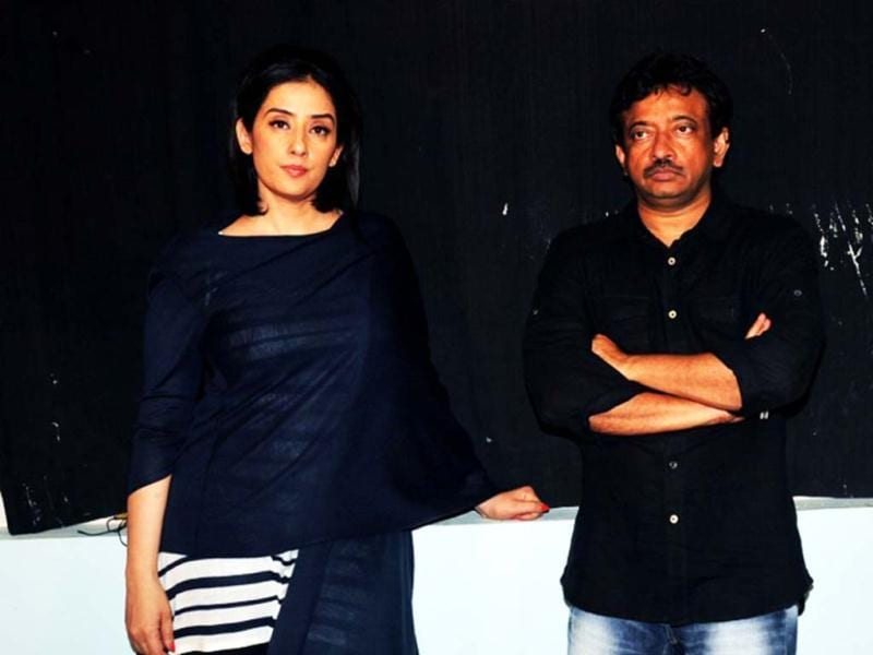 Manisha Koirala (L) and RGV strike a pose for shutterbugs. (AFP)