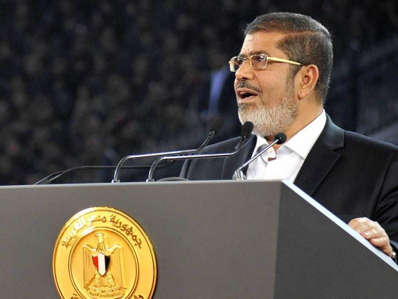 Egypt's President Mohammed Mursi speaks to the nation at Cairo stadium to mark the anniversary of Egypt's successful crossing of the Suez Canal in its October 1973 war against Israel. Reuters/Egyptian Presidency/Handout