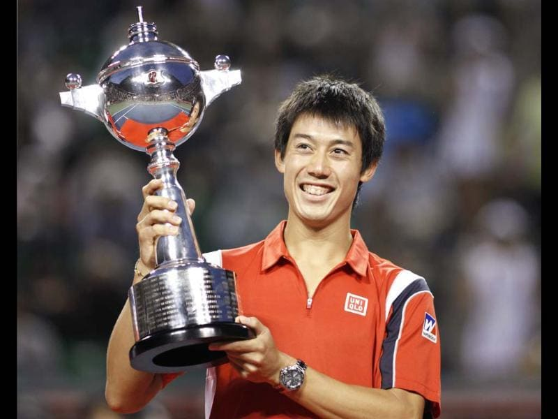 Kei Nishikori of Japan celebrates with his trophy after his victory against Milos Raonic of Canada in the men's singles finals match at the Japan Open tennis championships in Tokyo. Reuters/Yuriko Nakao