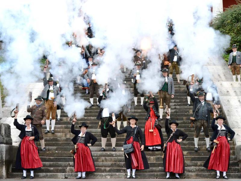 Bavarian riflemen fire gun salute on the steps of the Bavaria monument at the Theresienwiese fair grounds of the Oktoberfest beer festival in Munich. AFP Photo
