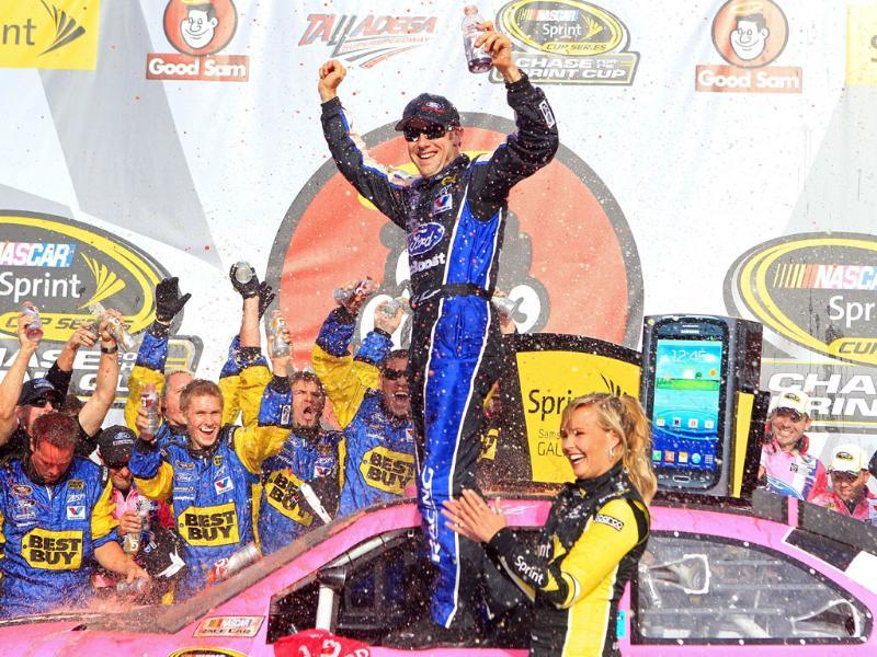Matt Kenseth, driver of the #17 Ford Ecoboost/National Breast Cancer Foundation Ford, celebrates in Victory Lane after winning the NASCAR Sprint Cup Series Good Sam Roadside Assistance 500 at Talladega Superspeedway in Talladega, Alabama. AFP/Sean Gardner