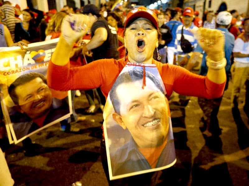 Supporters of Venezuelan president Hugo Chavez gather outside Miraflores Palace to wait for the results of Presidential elections in Caracas. Reuters/Jorge Silva