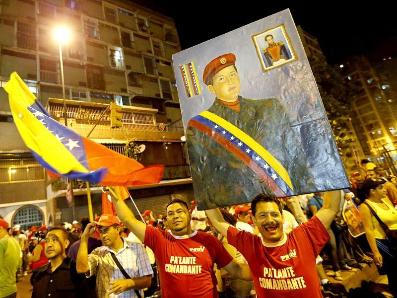 Supporters of Venezuelan president Hugo Chavez gather outside Miraflores Palace to wait for the results of Presidential elections in Caracas. Chavez won the elections with 54.42% of votes. Reuters/Jorge Silva