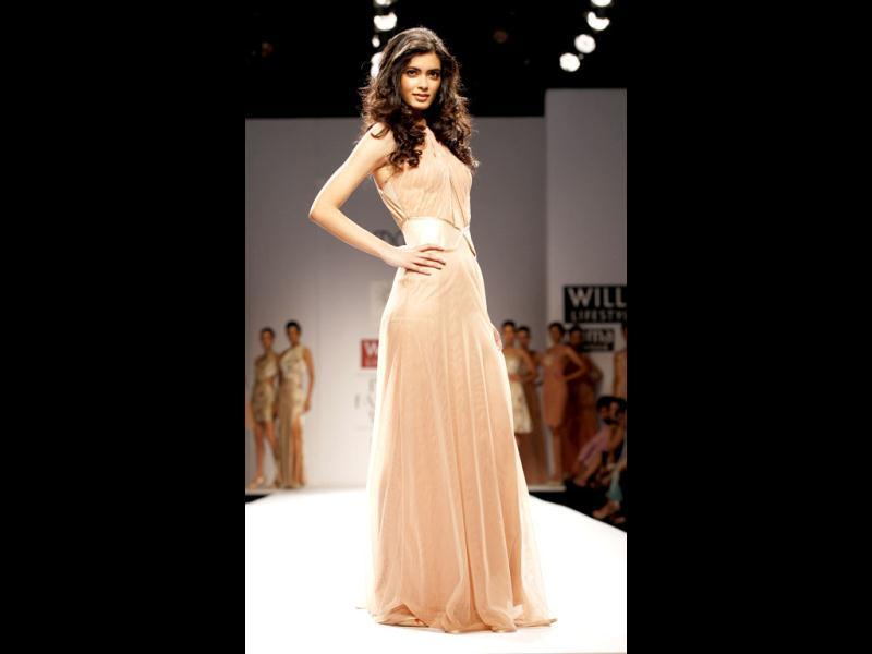 Dressed in a salmon pink gown, Diana Penty marched down the ramp looking elegant on the second day of Wills India Fashion Week (WIFW). She enjoyed flaunting the outfit with little detailing because