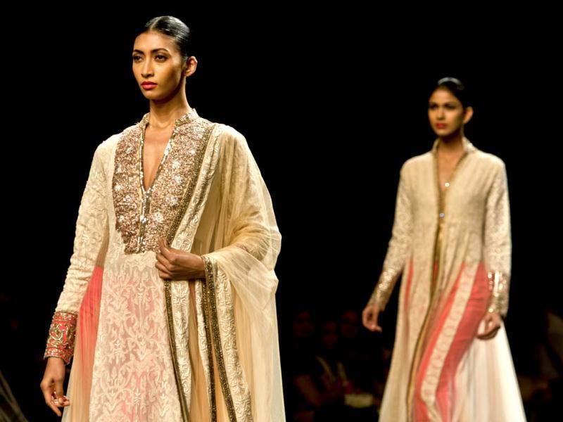 Models display creations by Manish Malhotra during the Wills Lifestyle India Fashion Week in New Delhi, India. (AP Photo/Tsering Topgyal)