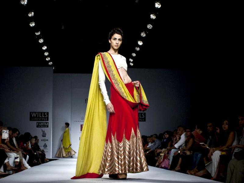 A model displays a creation by Anand Kabra during the Wills Lifestyle India Fashion Week in New Delhi, India, Saturday, Oct. 6, 2012. (AP Photo/Tsering Topgyal)