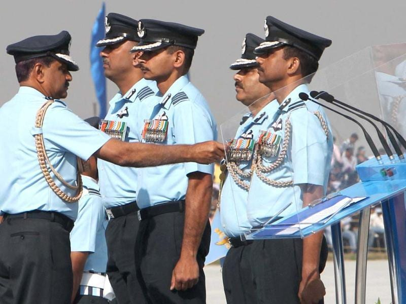 Air Chief Marshal NAK Browne honouring IAF personnel during the Air Force Day celebrations in Hindon. PTI Photo