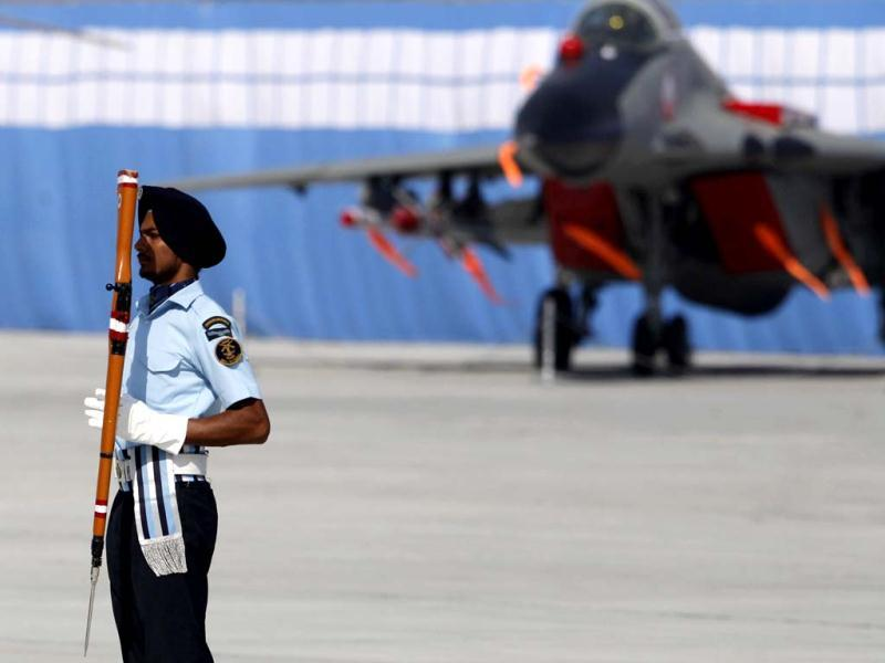 IAF drill team member displays rifle handling skills during Air Force Day celebrations in Hindon. AP Photo