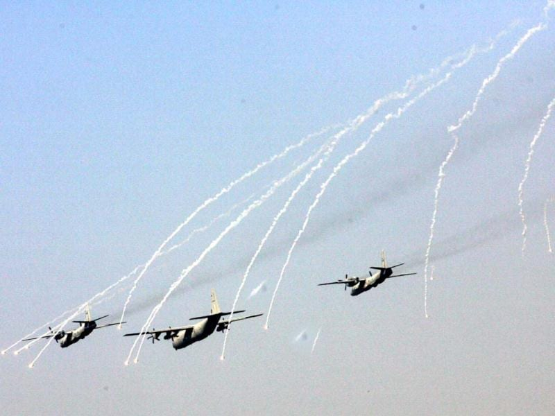 Transport aircrafts of the IAF relasing flares while participating in a airshow during the anniversary of the IAF at Hindon. UNI Photo