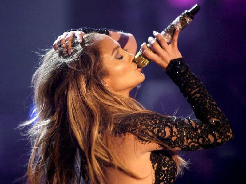 JLo shows just how to sizzle the stage, both with her scintillating singing and her sensuous movies.