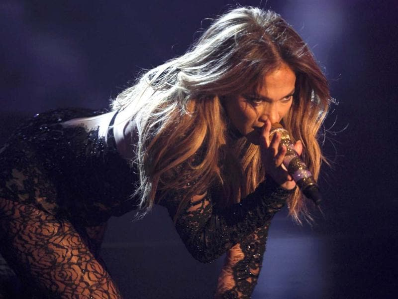 Wild cat Jennifer Lopez goes on all fours to steam things up at the game show Wetten Dass (Bet it...?) in the Western German town of Duesseldorf.