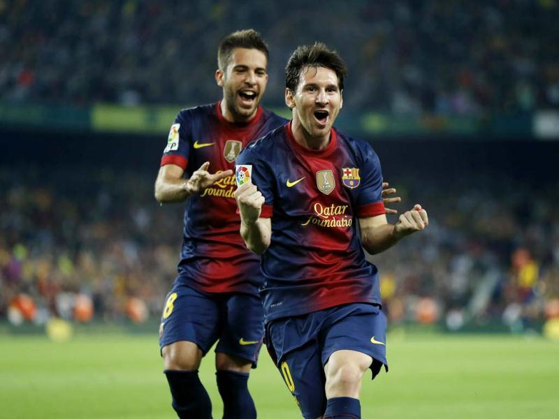 Barcelona's Lionel Messi from Argentina, right, celebrates after scoring a goal against Real Madrid's during a Spanish La Liga soccer match at the Camp Nou Stadium, in Barcelona. (AP Photo)