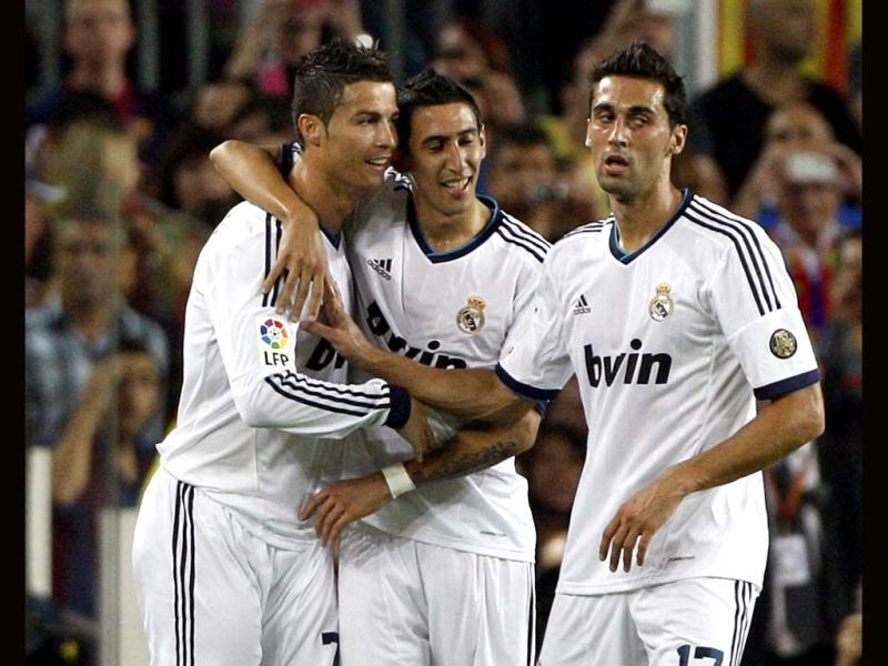 Real Madrid's Cristiano Ronaldo celebrates with teammates Angel di Maria and Alvaro Arbeloa after scoring against Barcelona during their Spanish first division soccer match at Nou Camp stadium in Barcelona. (Reuters)