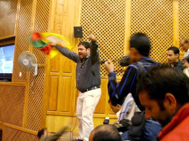 A youth shouts slogans in Jammu and Kashmir assembly in Srinagar. The Jammu and Kashmir assembly witnessed unruly scenes as three youth jumped into the members' area of the House, demanding implementation of employment policy. PTI