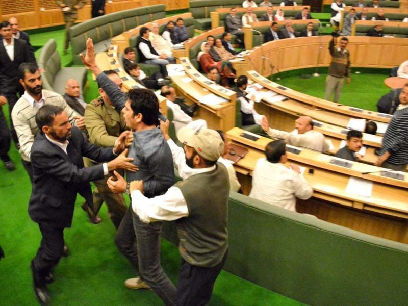 Marshalls take away a man, who was protesting against the state government's employment policy inside Jammu and Kashmir assembly, in Srinagar. HT/Waseem Andrabi