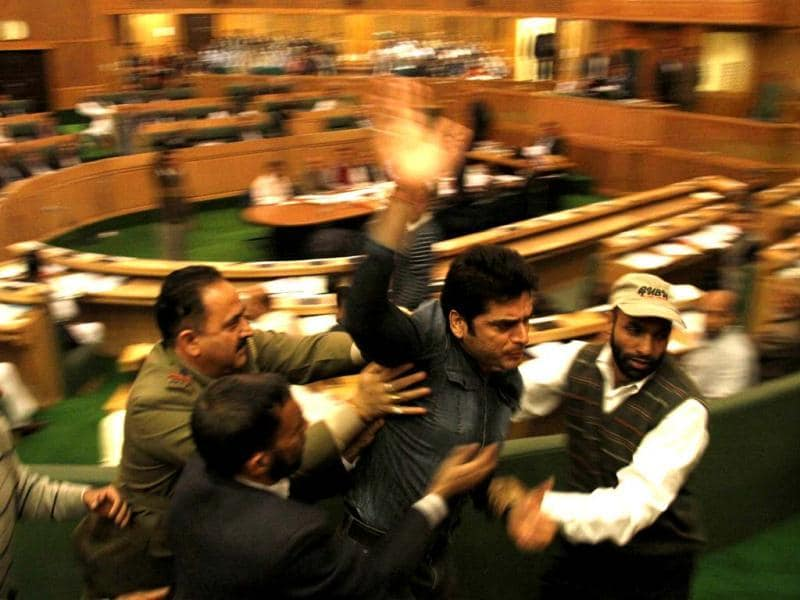 Marshalls take away a protester, who was protesting against the state government's employment policy inside the Jammu and Kashmir assembly during the session, in Srinagar. HT/Waseem Andrabi