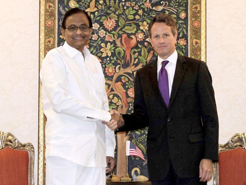 Finance minister Palaniappan Chidambaram (L) shakes hands with US Treasury Secretary Timothy Geithner before their meeting in New Delhi. Geithner is on a two-day visit to India. REUTERS/B Mathur