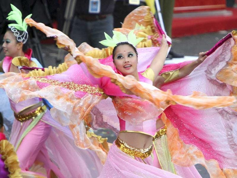 Taiwanese students perform during National Day celebrations marking the 101st anniversary of the founding of the Republic of China, in front of the Presidential Office in Taipei, Taiwan. AP Photo/Chiang Ying-ying
