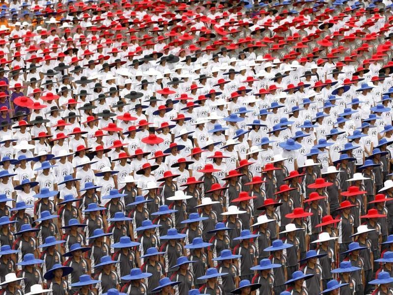 People wearing hats in the colours of Taiwan's national flag take part in the country's National Day celebrations in front of the Presidential office in Taipei. Reuters/Pichi Chuang