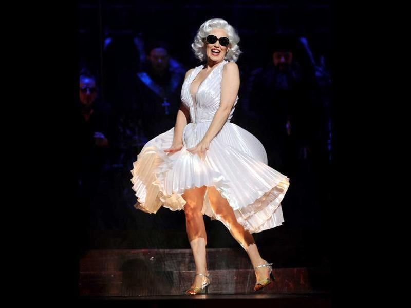 A performer dressed as Marilyn Monroe reacts during the 'Dance of the Seven Veils' in a full dress rehearsal for the Opera Australia production of 'Salome' at the Sydney Opera House. Salome, which opens in Sydney on October 12, is an explosive and outrageous story of sex, death and religion and includes the famous 'Dance of the Seven Veils' featuring seven mini dance routines. AFP PHOTO / Greg WOOD