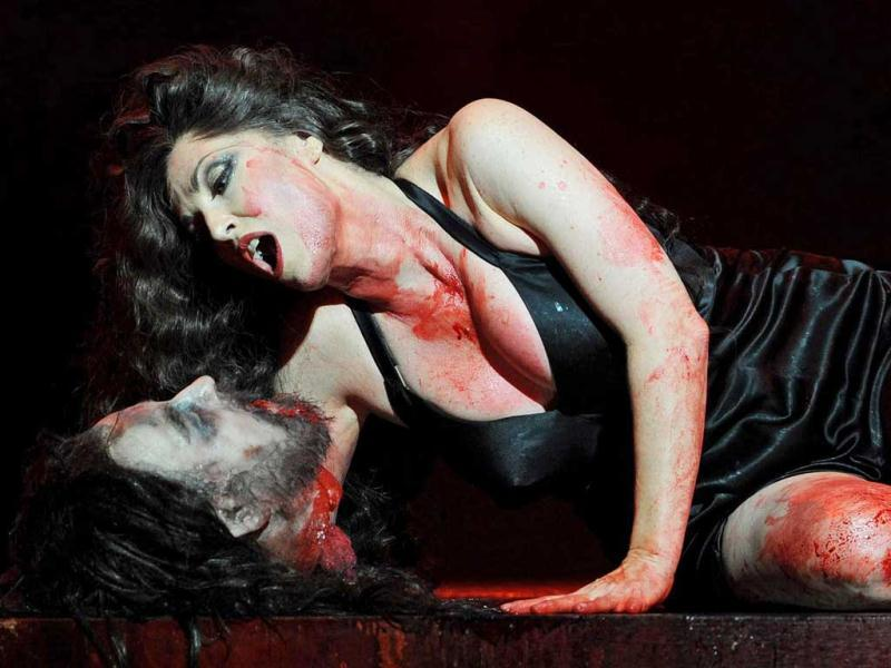 Cheryl Barker, playing 'Salome', performs with the severed head of 'Jokanaan' (John the Baptist), during a full dress rehearsal for the Opera Australia production of 'Salome' at the Sydney Opera House. AFP PHOTO / Greg WOOD