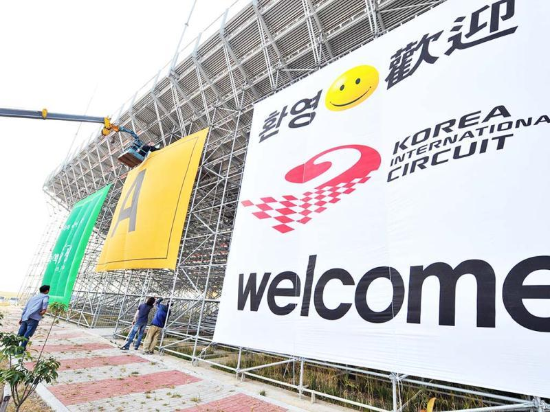 South Korean workers attach a banner to the backside of the grandstands at the Korean Circuit in Yeongam. AFP photo