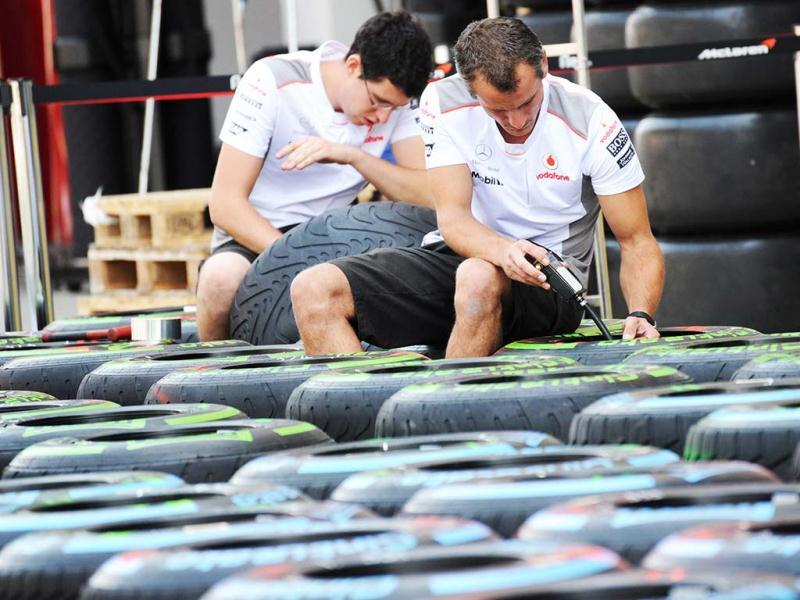 Members of the McLaren Mercedes team check tyres ahead of the Formula One Korean Grand Prix in Yeongam. AFP photo