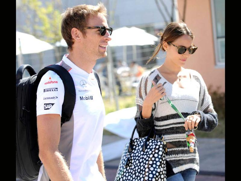 McLaren-Mercedes driver Jenson Button of Britain (L) and his girlfriend Jessica Michibata (R) arrive at the paddock of the Korean Circuit in Yeongam one day before the start of the Formula One Korean Grand Prix. AFP photo