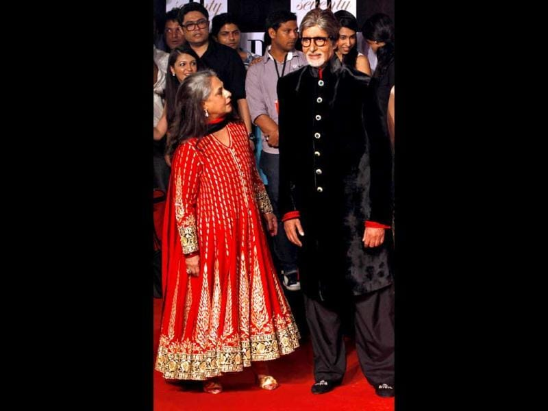 Jaya Bachchan in a bright anarkali poses with hubby Amitabh Bachchan, who is seen in a black velvet sherwani.