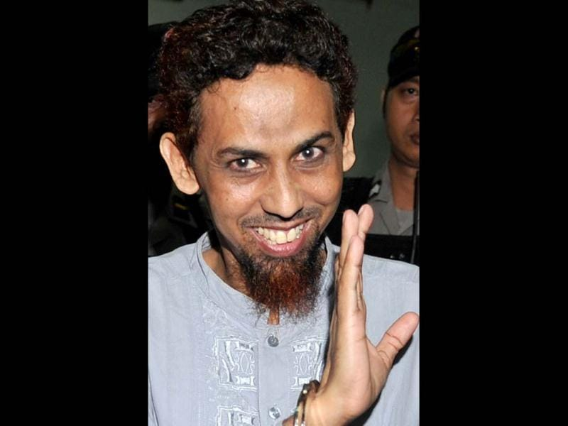 A file photo of convicted Indonesian Islamist Umar Patek gesturing towards journalists after his trial in Jakarta. AFP Photo