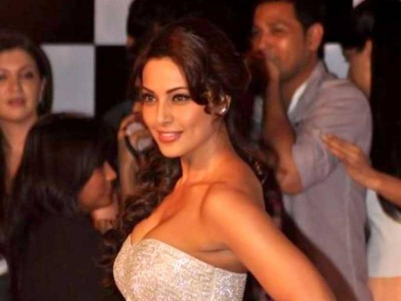 Bipasha Basu stuns in a white off-shoulder gown.