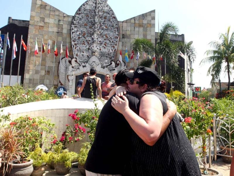 Australian survivors of 2002 Bali bombings hug each other in front of the Bali memorial monument as they pay their respect to victims who were killed in the nightclub bombings in Kuta, Bali. AP Photo