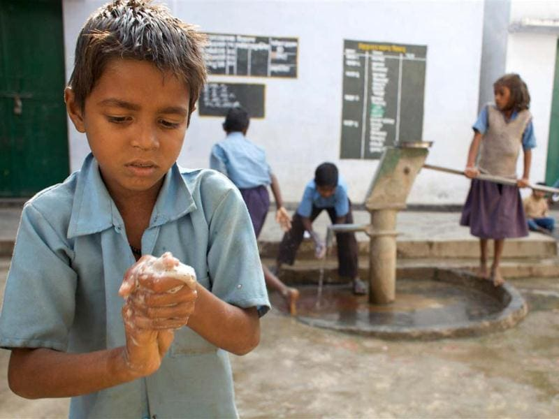 A school boy washes his hand before midday meal in a village primary school. Photo courtesy: Unicef