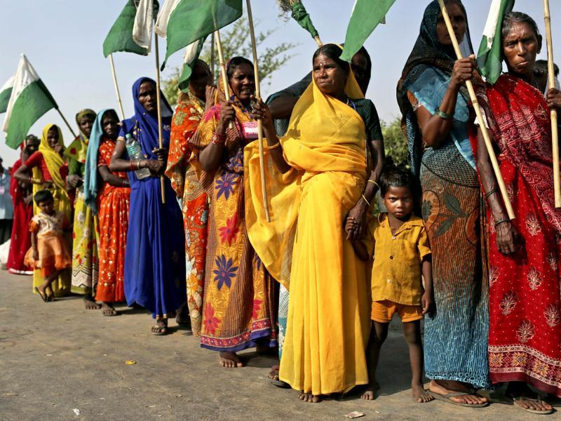 Landless farmers prepare for the day's march during the