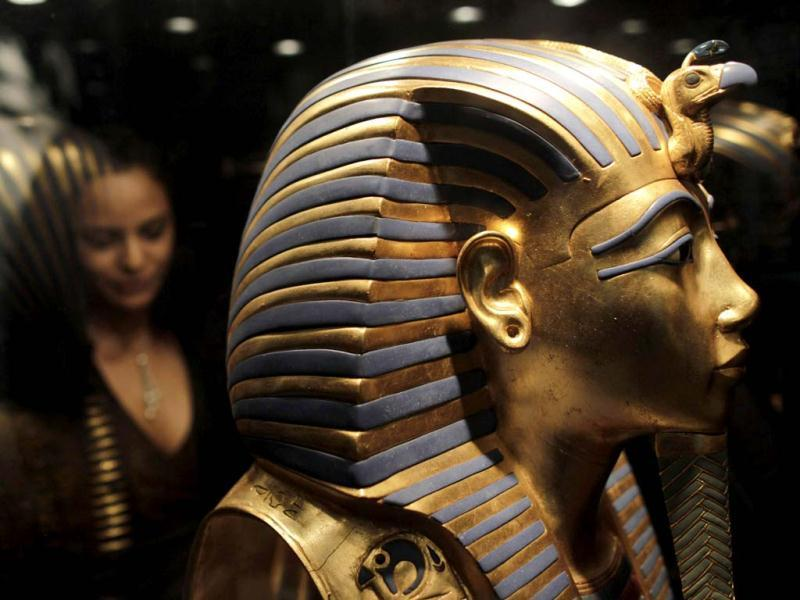 An employee looks at a replica of the golden death mask of Egyptian pharaoh Tutankhamun at the King Tutankhamun Exhibition in the Reina Torre de Arauz museum in Panama City. Reuters photo