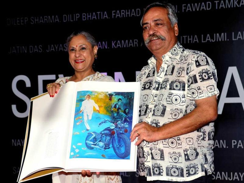 Jaya Bachchan flaunts one of the art works during the event.